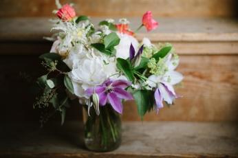 peony, astilbe, clematis vine, ladies mantle, seeded eucalyptus, poppies